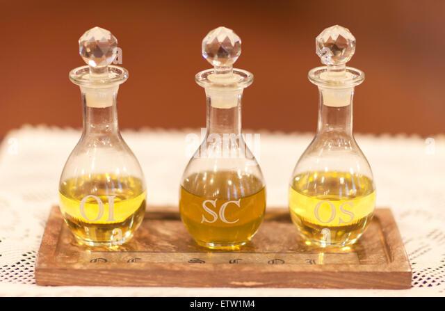 Bottles of Holy Oils or Sacramental Oils, Oleum Infirmorum, Sacrum Chrisma and Oleum Sanctorum in a Roman Catholic - Stock-Bilder