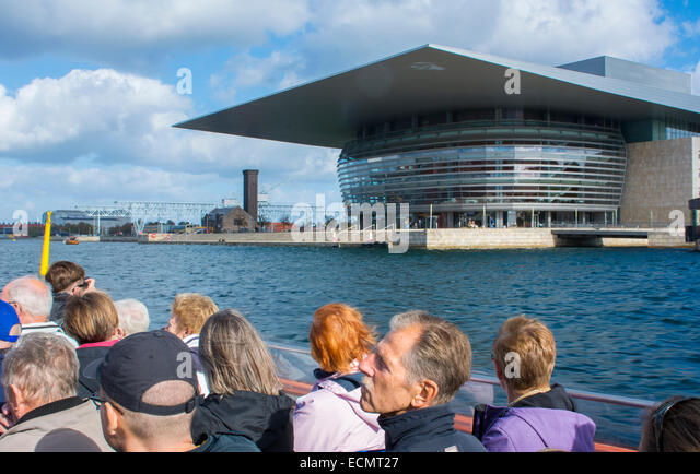 Copenhagen Denmark cruise on canal and new Opera House Kobenhavn tourists - Stock Image