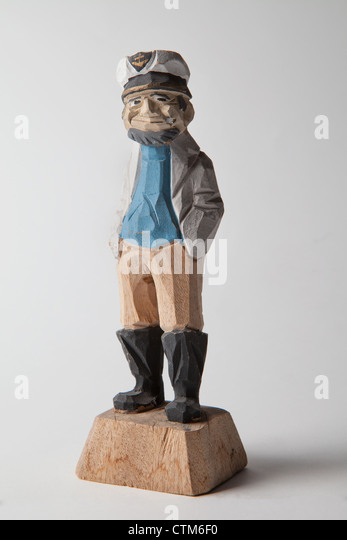 carved wooden sailors vintage kitch collectible sea navy captain sailor on white background fisherman European English - Stock Image