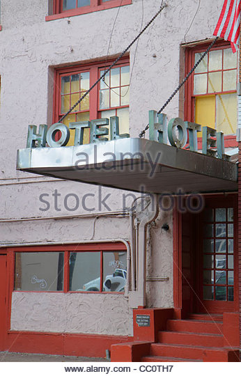 Louisiana New Orleans St. Charles Avenue dilapidated hotel low class budget stainless steel canopy marquee entrance - Stock Image