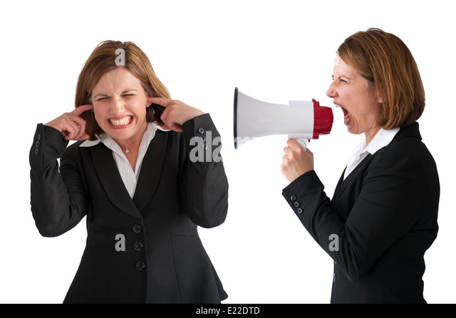 female employee being yelled or shouted at by female businesswoman manager using a loudhailer or megaphone isolated - Stock Image