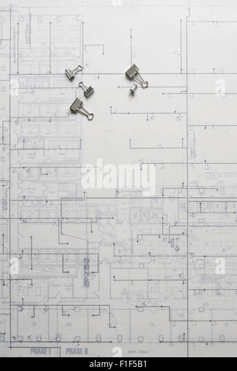 Still Life of blue print with push pins and binder clips. - Stock-Bilder