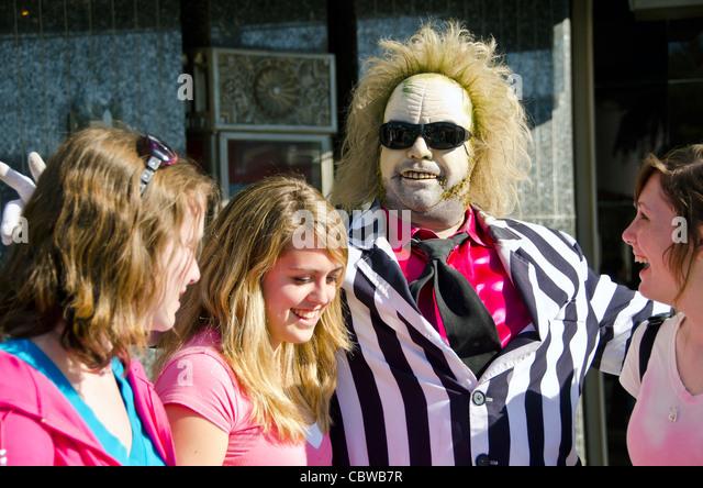 Beatlejuice Character with tourists Universal Studios Orlando Florida - Stock Image