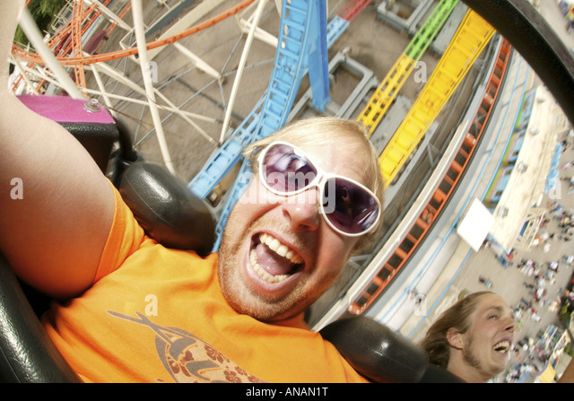 crazy young men driving roller coaster on the Crange fun fair, Germany, North Rhine-Westphalia, Ruhr Area, Herne - Stock Image