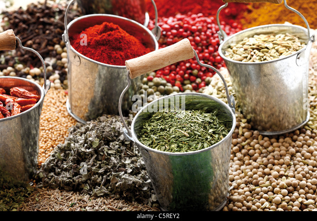 A selection of spices in zinc buckets, close-up - Stock Image