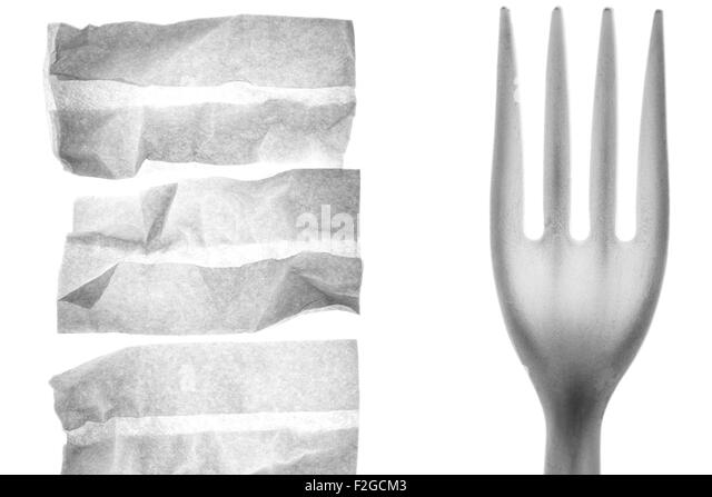 3 white napkins and a close-up of a plastic fork backlit on white - Stock Image
