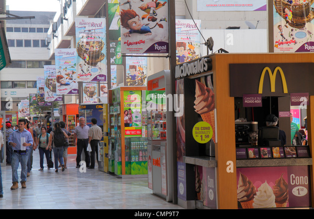 Peru Lima Real Plaza pedestrian mall food court shopping business business kiosk banner ad McDonald's to go - Stock Image