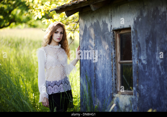 Portrait of young woman looking at camera - Stock Image