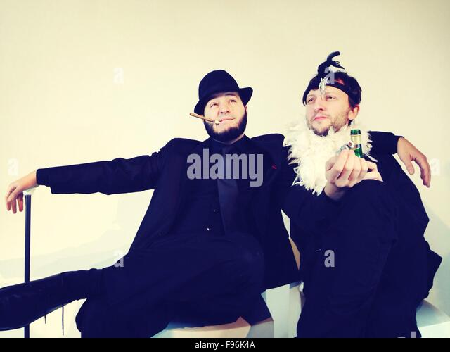 Gay Male Couple Sitting Together - Stock Image