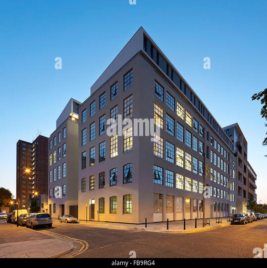 Corner elevation with street at night. The Textile Building, London, United Kingdom. Architect: BGY, 2014. - Stock Image