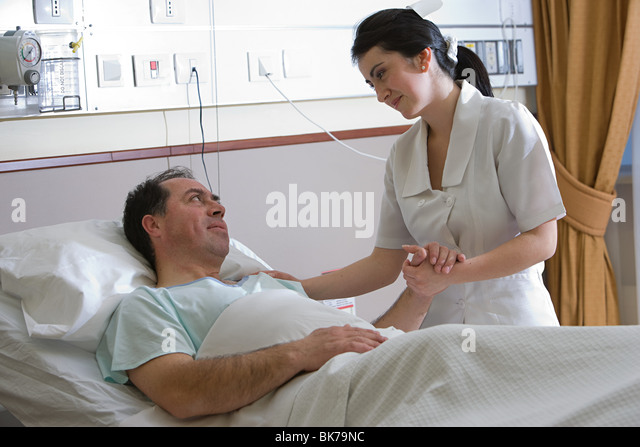 Nurse caring for patient - Stock Image