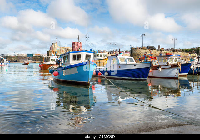 Fishing boats in the harbour at Newquay on the Cornwall coast - Stock Image