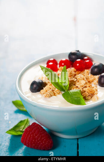 Healthy breakfast - yogurt with muesli and berries - health and diet concept - Stock Image