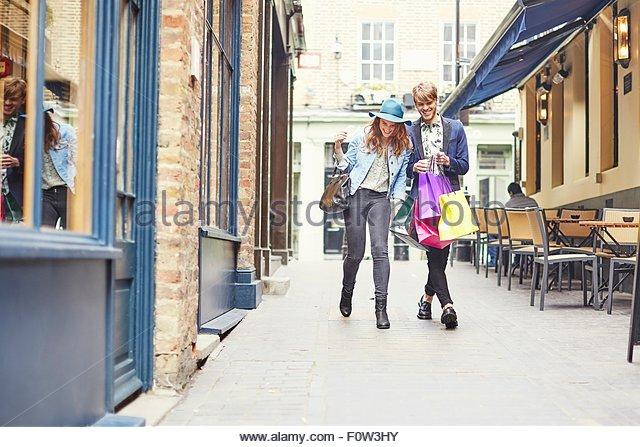 Stylish couple with shopping bags, London, UK - Stock Image