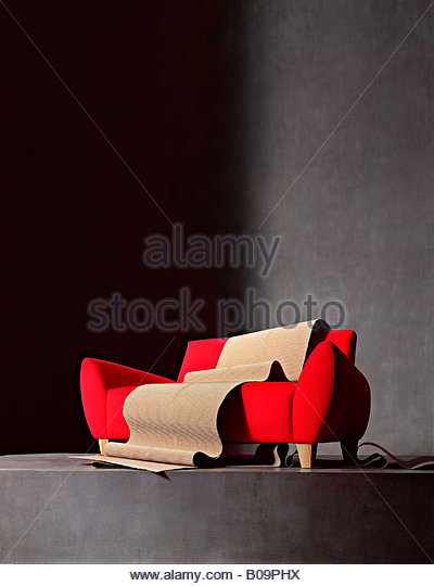red sofa and packaging - Stock Image