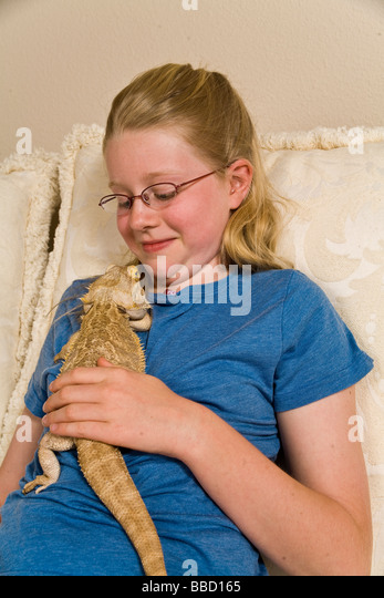 bearded dragon on a naked girl