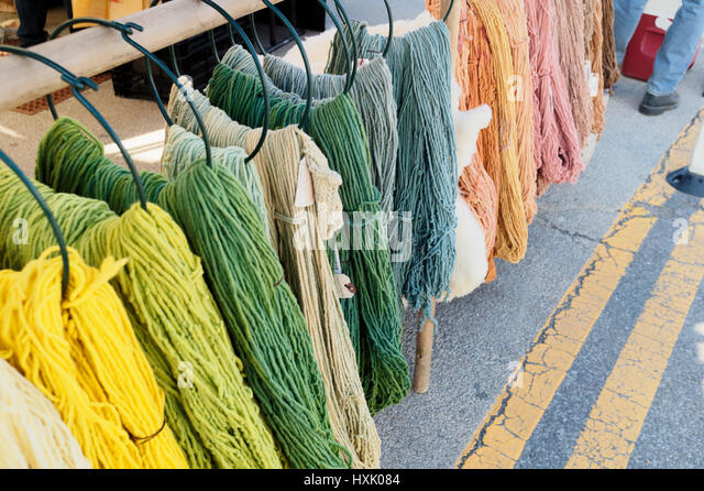 Hand dyed wool at the farmer's market in vibrant colors. - Stock Image