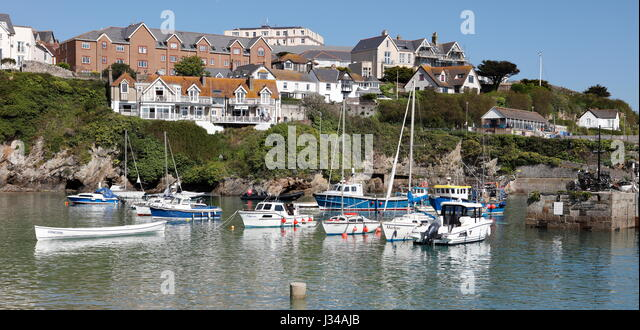 NEWQUAY, CORNWALL, UK - MAY 1, 2017: High pressure produces clear sunny skies over Newquay Harbour during a high - Stock Image