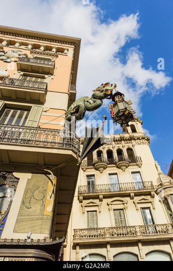 Dragon and Umbrella sign , La Rambla Barcelona, Catalonia, Spain - Stock Image