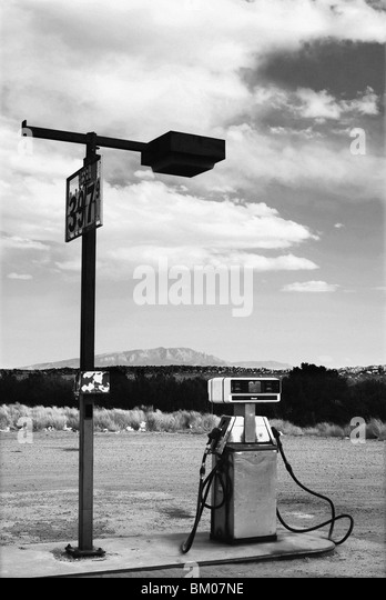 gas pump contrasts the natural landscape environment at big chief gas station, san ysidro, new mexico - Stock Image