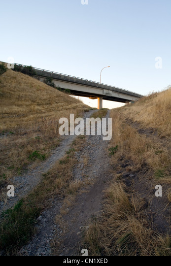 Dirt track and overpass, Vancouver, British Columbia, Canada - Stock Image
