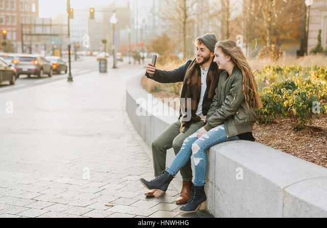 Young couple taking selfie in city, Boston, Massachusetts, USA - Stock Image