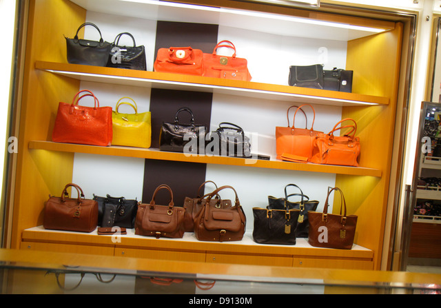 Hong Kong China International Airport HKG terminal concourse gate area shopping upscale luxury women's handbags - Stock Image