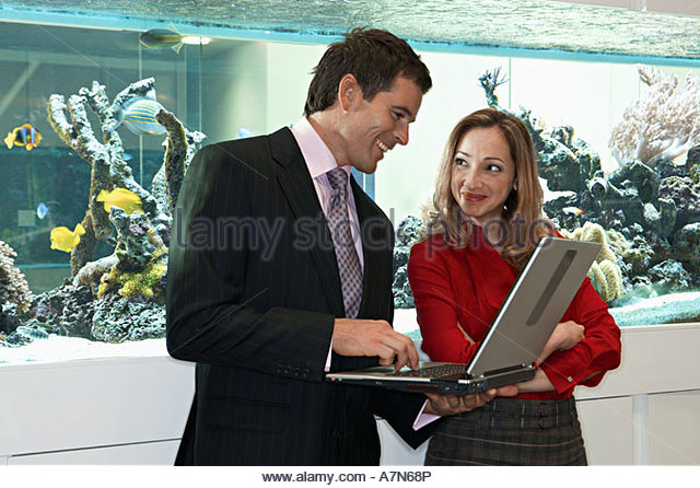 Side profile businessman businesswoman flirting stock for Fish 2 flirt