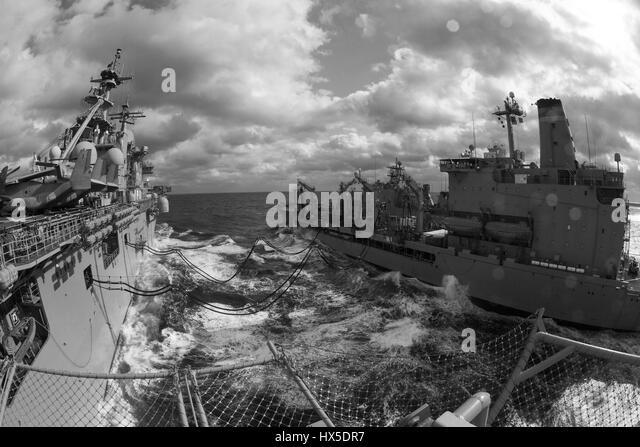 Amphibious assault ship USS Kearsarge (LHD 3) and Military Sealift Command fleet replenishment oiler USNS Big Horn - Stock Image