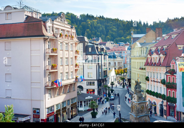 People walking on the Old Town street of Karlovy Vary. - Stock-Bilder