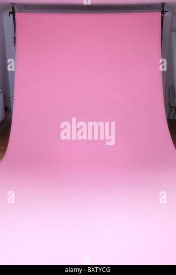 Pink photographic studio backdrop - Stock Image