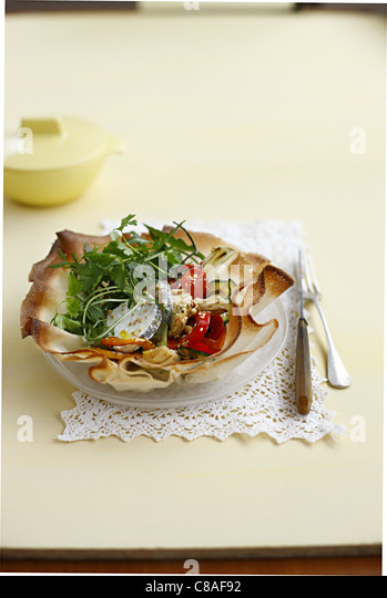 Filo pastry flower filled with confit vegetables and Sainte-Maure - Stock Image