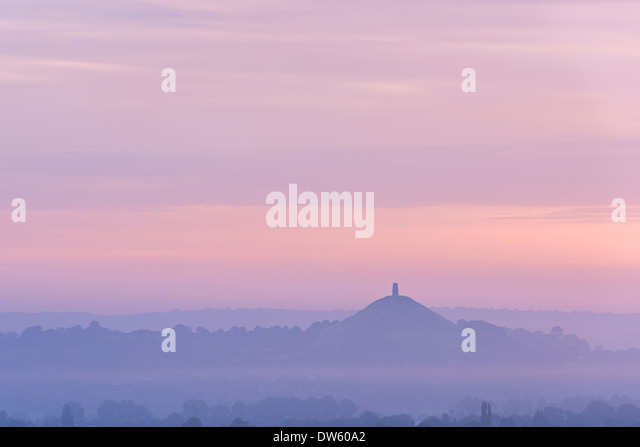 Glastonbury Tor rising surrounded by mist at dawn, Somerset, England. Summer (August) 2013. - Stock Image