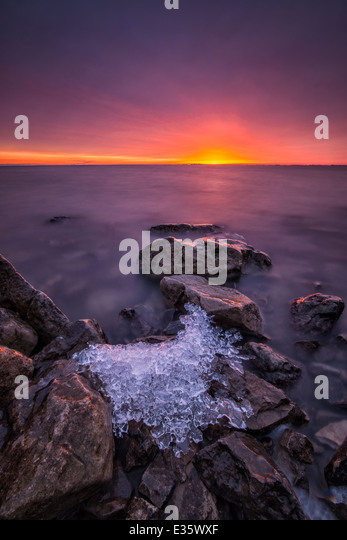 Last ice remains from winter on Lake St. Clair, Michigan - Stock Image