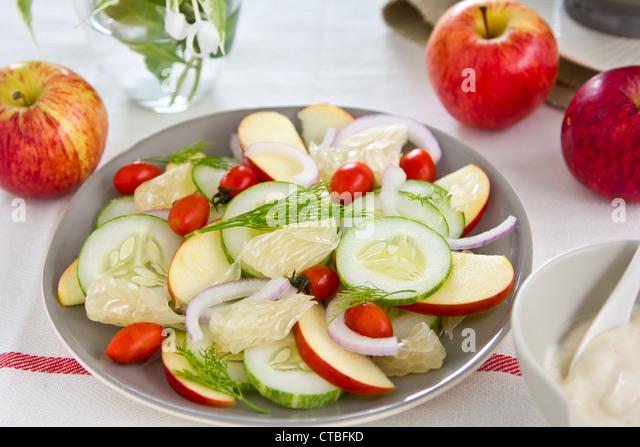 Apple  and Grapefruit salad with yogurt dressing - Stock Image