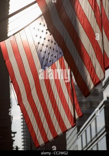 USA, New York City, Backlit American flags - Stock Image