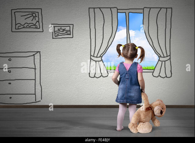 Child girl with toy bear look in the drawn window, dream concept - Stock Image