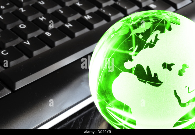 globalisation concept with glass planet on computer keyboard and copyspace - Stock Image