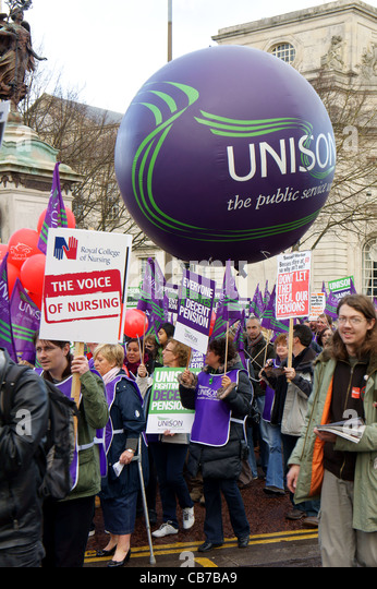 N30  Public Sector Strike and Rally in Cardiff, November 2011. Protesters are shown holding placards as they march - Stock Image
