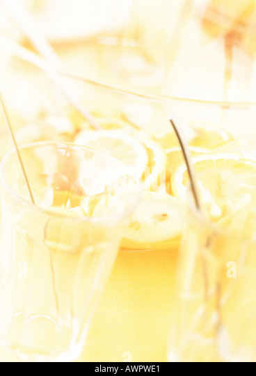 Bowl of punch and glasses, blurred, close-up - Stock Image