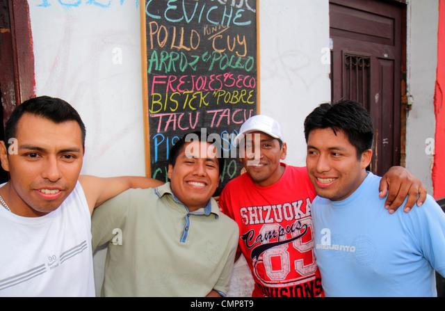 Peru Lima Barranco District Calle Rosello street scene bar business sidewalk Hispanic man young adults socializing - Stock Image