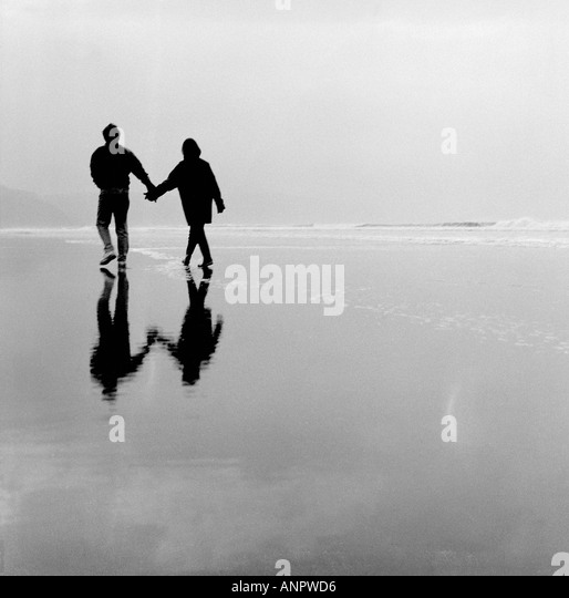 Romantic couple on Bude beach Cornwall UK - Stock Image