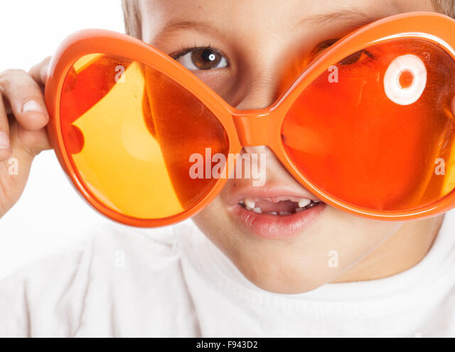 little cute boy in orange sunglasses pointing isolated close up part of face - Stock-Bilder
