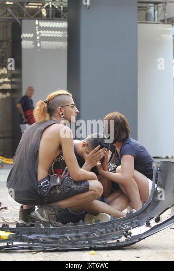 Barcelona, Spain. 17th Aug, 2017. Injured people react after a van crashes into pedestrians in Las Ramblas, downtown - Stock Image