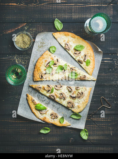 Homemade mushroom pizza with basil and rose wine - Stock Image