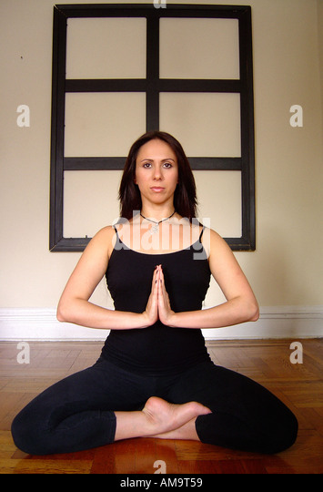 Portrait of Woman in Lotus Yoga Pose - Stock Image