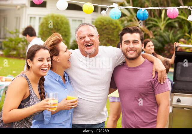 Parent With Adult Children Enjoying Party In Garden - Stock Image