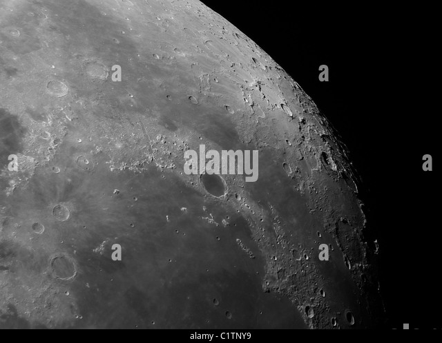 Close-up view of the moon showing impact crater Plato. - Stock Image
