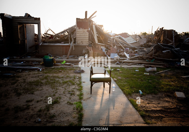 Tornado devastation in Tuscaloosa, Alabama.  Chair left behind in the rubble of destroyed homes. - Stock Image