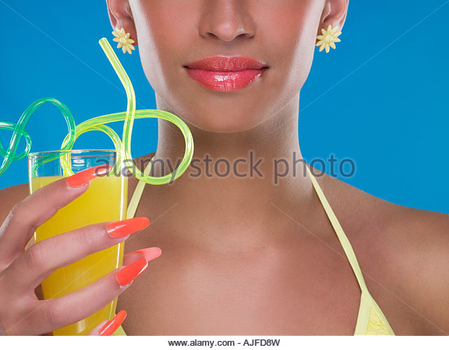 Woman holding a drink with curly straws - Stock-Bilder